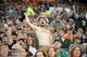 Aug 29, 2014; Denver, CO, USA; Colorado State Rams fan cheers during the game against the Colorado Buffaloes in the fourth quarter at Sports Authority Field at Mile High. The Rams defeated the Buffaloes 31-17. Mandatory Credit: Ron Chenoy-USA TODAY Sports