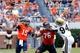 Aug 30, 2014; Charlottesville, VA, USA; Virginia Cavaliers quarterback Matt Johns (15) throws the ball as UCLA Bruins defensive lineman Owamagbe Odighizuwa (94) defends in the fourth quarter at Scott Stadium. The Bruisn won 28-20. Mandatory Credit: Geoff Burke-USA TODAY Sports