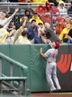 Aug 31, 2014; Pittsburgh, PA, USA; Pittsburgh Pirates fans reach for a home run ball hit by Josh Harrison (not pictured) as Cincinnati Reds left fielder Ryan Ludwick (48) reacts during the first inning at PNC Park. Mandatory Credit: Charles LeClaire-USA TODAY Sports
