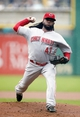 Aug 31, 2014; Pittsburgh, PA, USA; Cincinnati Reds starting pitcher Johnny Cueto (47) delivers a pitch against the Pittsburgh Pirates during the first inning at PNC Park. Mandatory Credit: Charles LeClaire-USA TODAY Sports