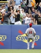 Aug 31, 2014; Pittsburgh, PA, USA; Pittsburgh Pirates fans reach for a home run ball hit by Jordy Mercer (not pictured) as Cincinnati Reds left fielder Ryan Ludwick (48) reacts during the second inning at PNC Park. Mandatory Credit: Charles LeClaire-USA TODAY Sports