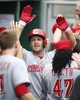Aug 31, 2014; Pittsburgh, PA, USA; Cincinnati Reds right fielder Chris Heisey (center) receives high-fives in the dugout after hitting a two run home run against the Pittsburgh Pirates during the fifth inning at PNC Park. The Reds won 3-2. Mandatory Credit: Charles LeClaire-USA TODAY Sports
