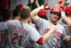 Aug 31, 2014; Pittsburgh, PA, USA; Cincinnati Reds first baseman Todd Frazier (21) celebrates with right fielder Chris Heisey (28) in the dugout after Heisey hit a two run home run against the Pittsburgh Pirates during the fifth inning at PNC Park. The Reds won 3-2. Mandatory Credit: Charles LeClaire-USA TODAY Sports