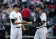 Aug 31, 2014; Chicago, IL, USA; Chicago White Sox relief pitcher Jake Petricka (52) shakes hands with catcher Tyler Flowers (21) after the game against the Detroit Tigers at U.S Cellular Field. Mandatory Credit: Jerry Lai-USA TODAY Sports