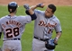 Sep 1, 2014; Cleveland, OH, USA; Detroit Tigers designated hitter Miguel Cabrera (24) celebrates his solo home run with left fielder J.D. Martinez (28) in the eighth inning against the Cleveland Indians at Progressive Field. Mandatory Credit: David Richard-USA TODAY Sports