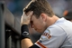 Sep 1, 2014; Denver, CO, USA; San Francisco Giants catcher Buster Posey (28) reacts in the dugout during the ninth inning against the Colorado Rockies at Coors Field. The Rockies defeated the Giants 10-9. Mandatory Credit: Ron Chenoy-USA TODAY Sports