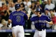 Sep 2, 2014; Denver, CO, USA; Colorado Rockies second baseman DJ LeMahieu (9) celebrates with short stop Josh Rutledge (14) after hitting a two run home run in the third inning against the San Francisco Giants at Coors Field. Mandatory Credit: Isaiah J. Downing-USA TODAY Sports