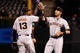 Sep 2, 2014; Denver, CO, USA; San Francisco Giants third baseman Joaquin Arias (13) and first baseman Travis Ishikawa (45) celebrate a 12-7 win over the Colorado Rockies at Coors Field. Mandatory Credit: Isaiah J. Downing-USA TODAY Sports