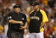 Aug 29, 2014; Pittsburgh, PA, USA; Home plate umpire Fieldin Culbreth (25) and Pittsburgh Pirates manager Clint Hurdle (13) discuss a possible replay challenge against the Cincinnati Reds during the eighth inning at PNC Park. The Pirates won 2-1. Mandatory Credit: Charles LeClaire-USA TODAY Sports