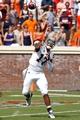 Aug 30, 2014; Charlottesville, VA, USA; UCLA Bruins quarterback Brett Hundley (17) throws the ball against the Virginia Cavaliers at Scott Stadium. Mandatory Credit: Geoff Burke-USA TODAY Sports