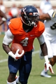 Aug 30, 2014; Charlottesville, VA, USA; Virginia Cavaliers running back Taquan Mizzell (4) carries the ball against the UCLA Bruins at Scott Stadium. Mandatory Credit: Geoff Burke-USA TODAY Sports