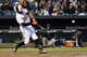 Apr 28, 2016; Baltimore, MD, USA;  Baltimore Orioles center fielder Adam Jones (10) hits an RBI double during the first inning against the Chicago White Sox at Oriole Park at Camden Yards. Mandatory Credit: Tommy Gilligan-USA TODAY Sports