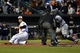 Apr 28, 2016; Baltimore, MD, USA; Baltimore Orioles first baseman Chris Davis (19) looks back at home plate umpire Cory Blaser (89)  as he is called out of Chicago White Sox catcher Hector Sanchez (29) tag during the first inning at Oriole Park at Camden Yards. Mandatory Credit: Tommy Gilligan-USA TODAY Sports