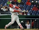 Apr 28, 2016; Washington, DC, USA; Philadelphia Phillies catcher Cameron Rupp (29) hits a two run RBI double against the Washington Nationals during the ninth inning at Nationals Park. Mandatory Credit: Brad Mills-USA TODAY Sports