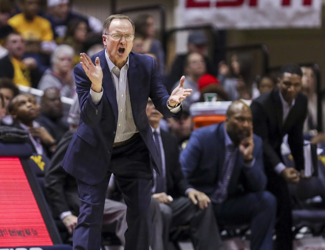 Which College Basketball Coach had the Most Losses During Their Career?